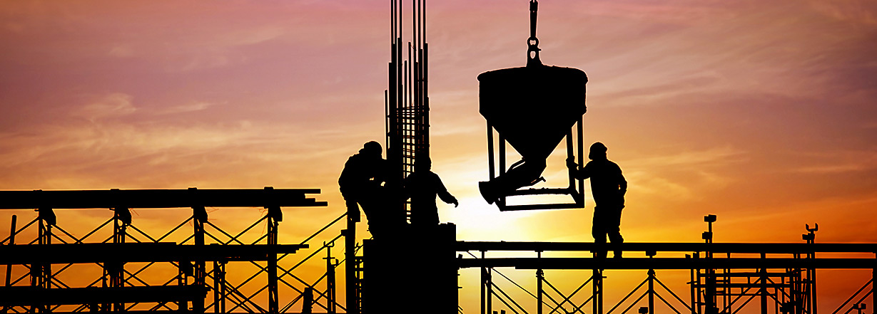 Image of construction at sunset.